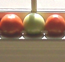 2 red tomatoes with green one in between